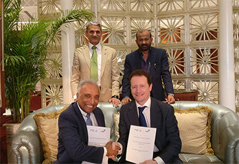 Photo of Luis Jorge Romero and Rajan S Mathews showing the signed MoU