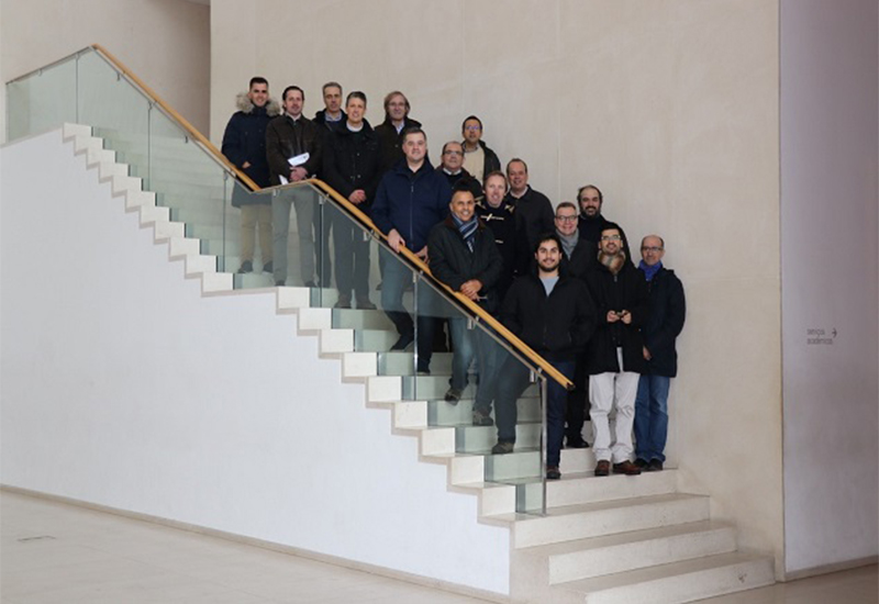Participants of the event standing on stairs