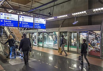 Image of RATP in Paris with train and people