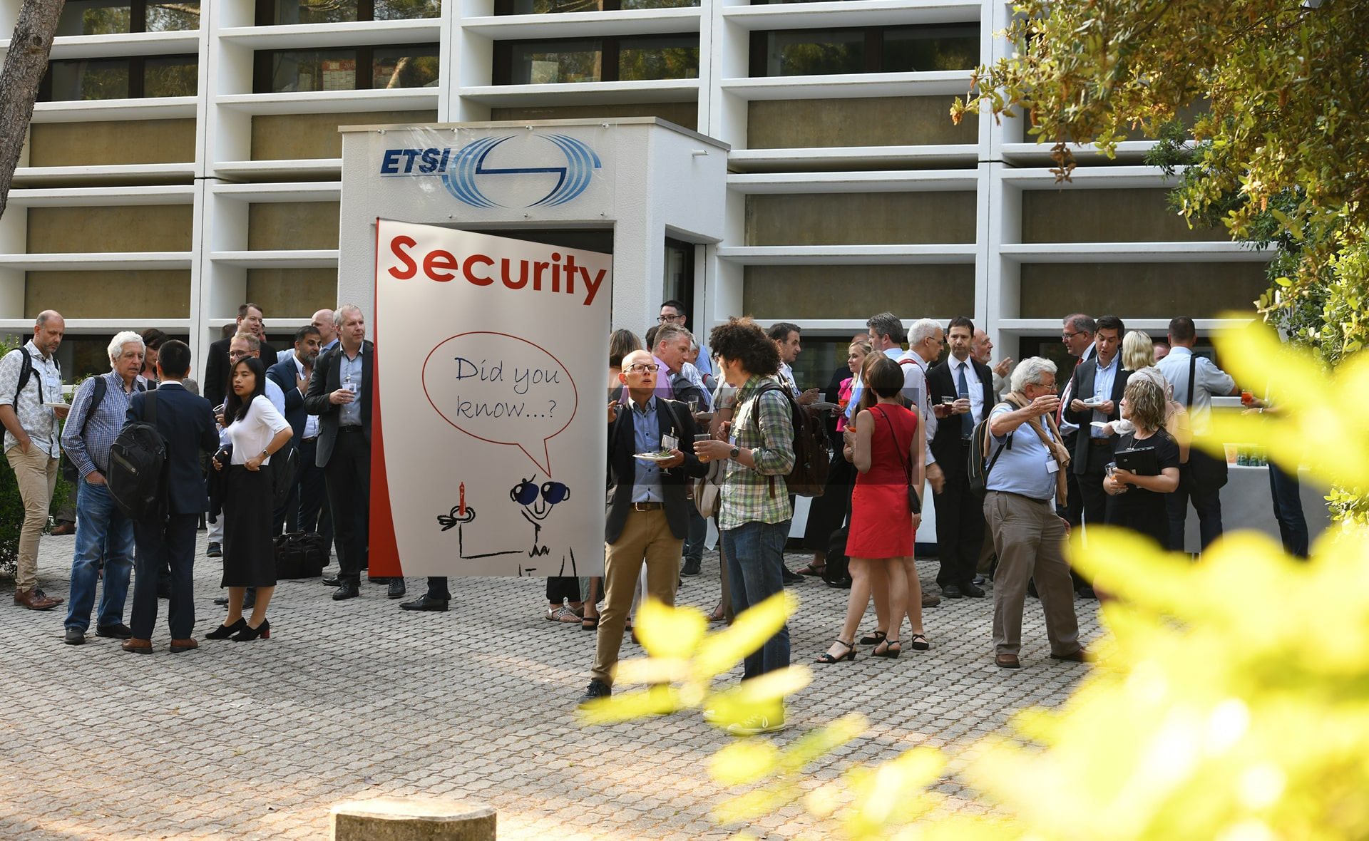 Participants at ETSI Security week in front of ETSI building networking